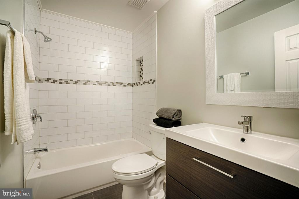 Hall bath updated. Modern feel & storage. - 4407 HILLYER ST, FAIRFAX