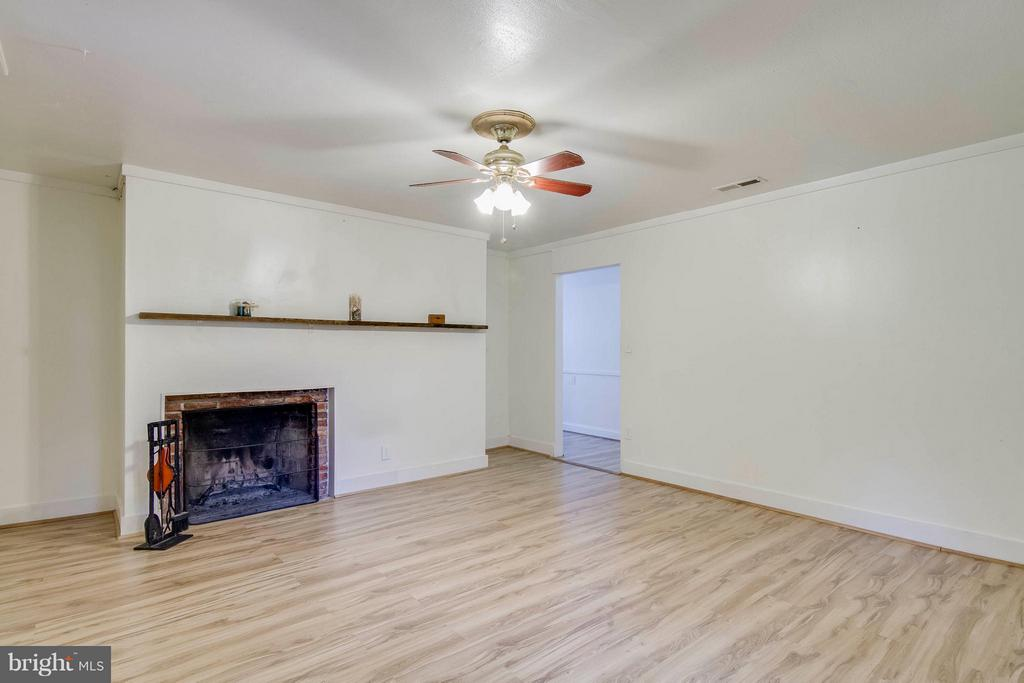 Living Room with wood burning fireplace - 13305 SPRIGGS RD, MANASSAS