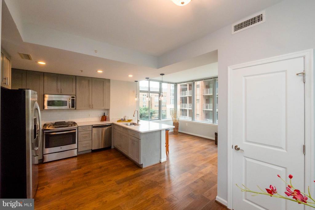 Kitchen with hew hardwood flooring - 11990 MARKET ST #217, RESTON