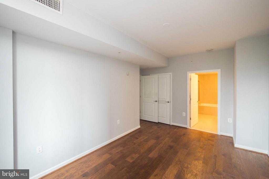 Generous master bedroom - 11990 MARKET ST #217, RESTON