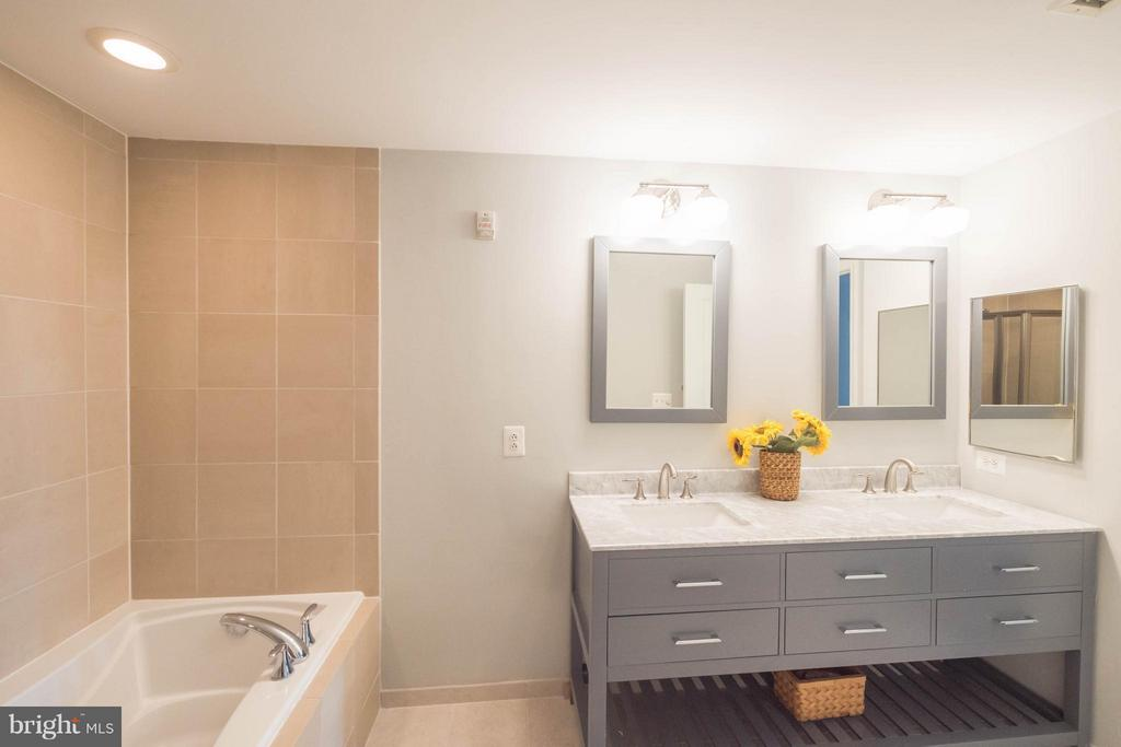 New vanity, mirrors, tile flooring, lighting - 11990 MARKET ST #217, RESTON