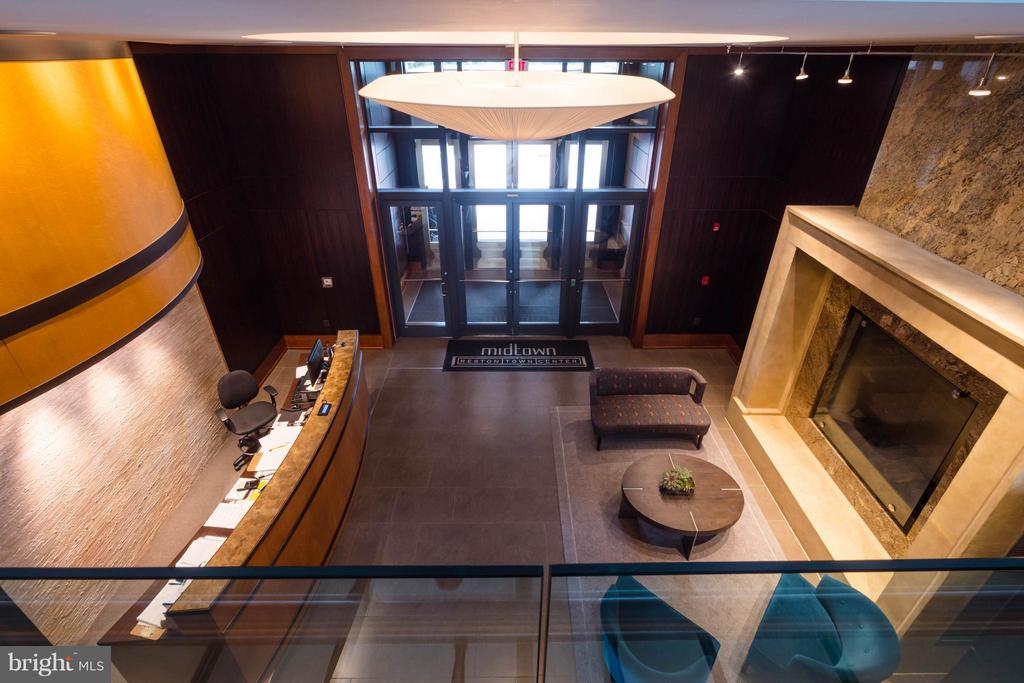 Lobby with full time concierge/doorman - 11990 MARKET ST #217, RESTON