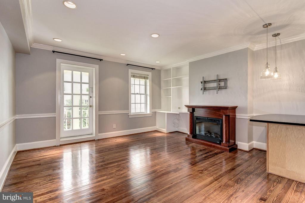 Living Room with built-in bookcases & desk - 3239 N ST NW #11, WASHINGTON