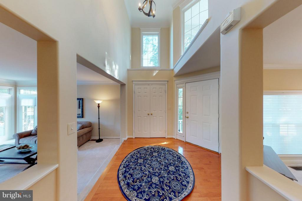 Interior view of two story foyer with maple floors - 9800 BOLTON VILLAGE CT, FAIRFAX