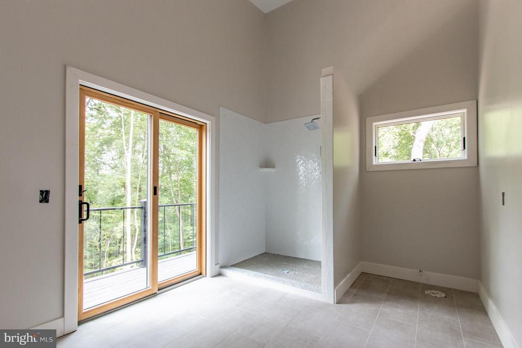 This bedroom has a full bath and balcony! - 6027 TULIP POPLAR CT, MANASSAS