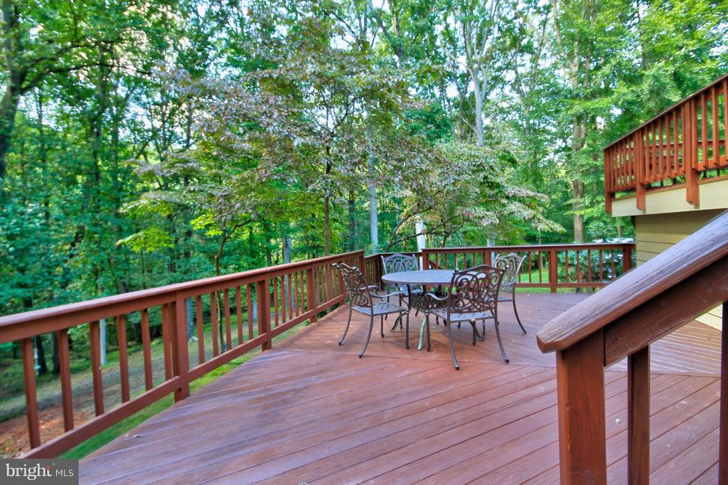 Extensive decking throughout home - 10714 MILKWEED DR, GREAT FALLS