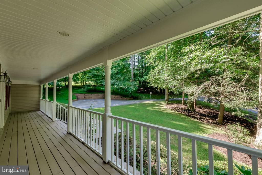 Wonderful woodland views from front porch - 9879 HEMLOCK HILLS CT, MANASSAS