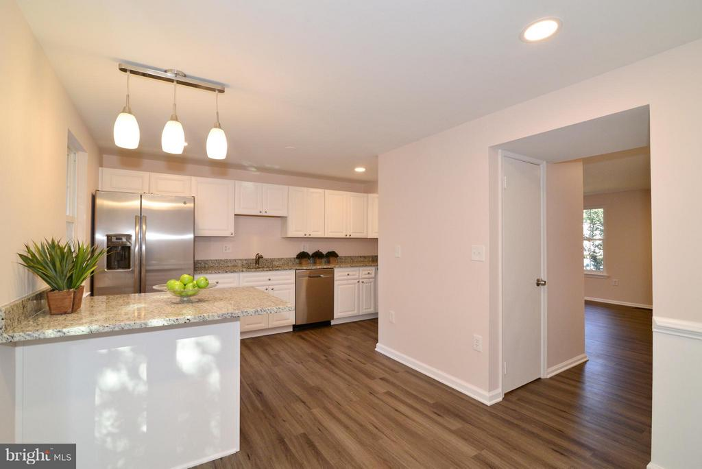 Kitchen with new island and pendant lighting. - 30 DORRELL CT, STERLING