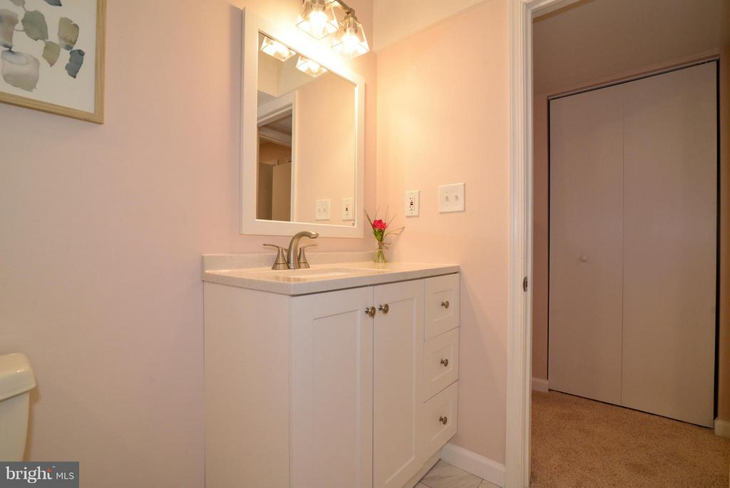 Another view of the lower level bathroom. - 30 DORRELL CT, STERLING