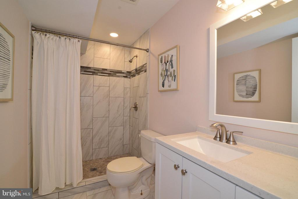 Beautifully-updated lower level bathroom. - 30 DORRELL CT, STERLING