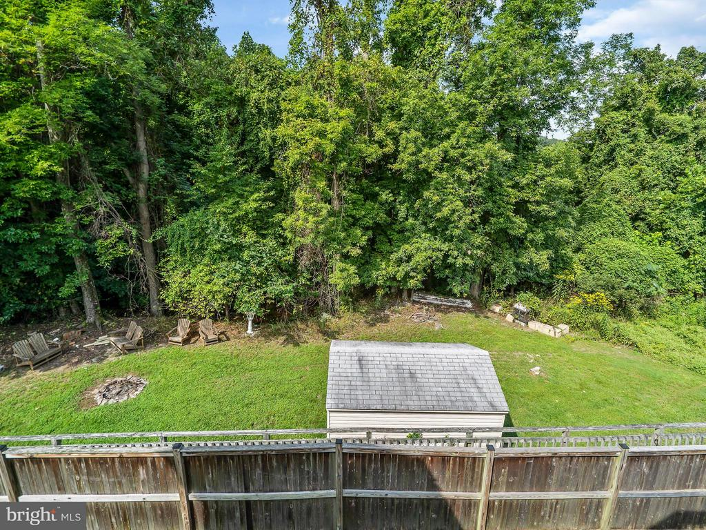 Fire pit and Storage Shed area backs to trees - 4406 BIRCHTREE LN, TEMPLE HILLS