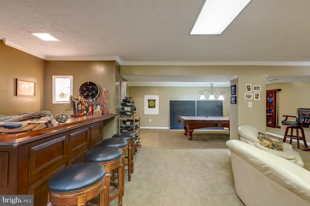 Lower Level has  bar area great for entertaining - 8651 WIND SONG CT, SPRINGFIELD
