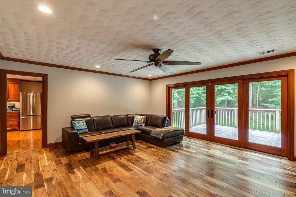 Family room on main level with a deck - 11905 CHAPEL RD, CLIFTON