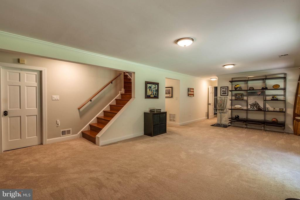 The lower level has another Family Room - 11905 CHAPEL RD, CLIFTON