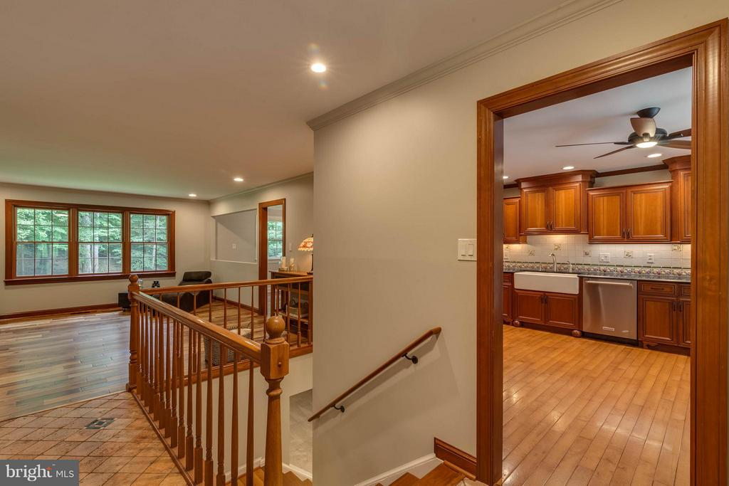 Such beautiful wood floors and trim greet you. - 11905 CHAPEL RD, CLIFTON