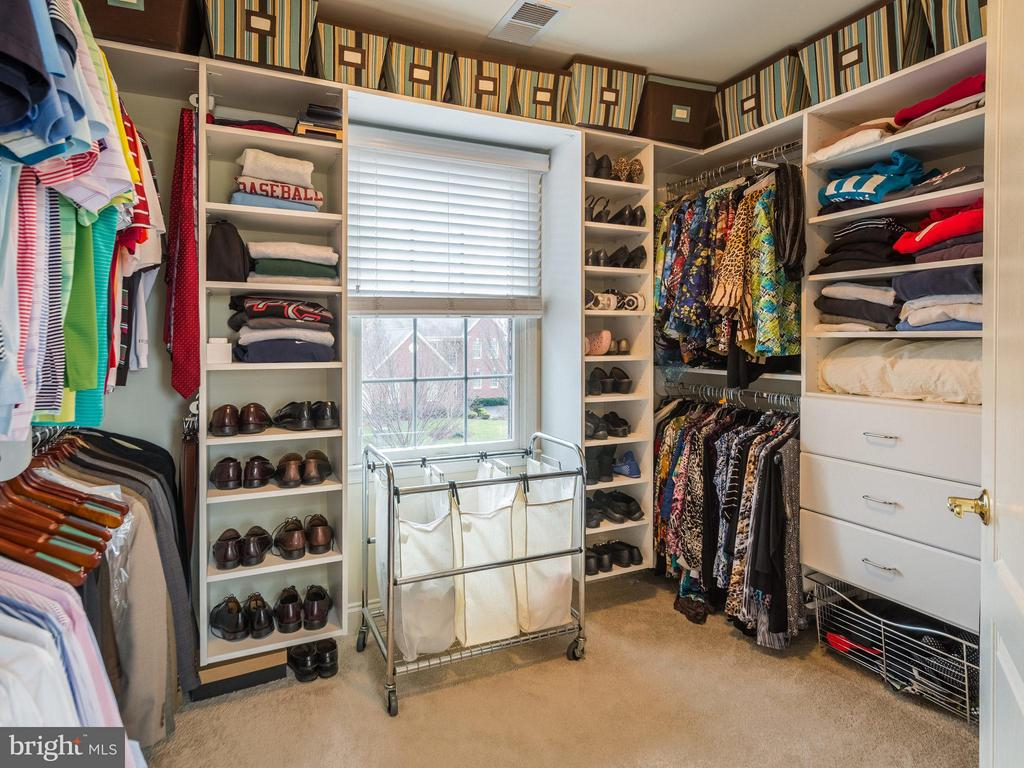 Custom designed master walk in closet - 19825 BETHPAGE CT, ASHBURN