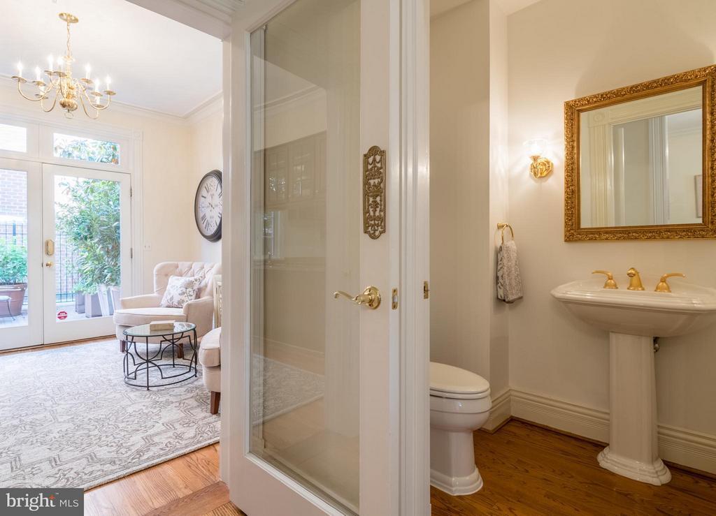 A quaint half bath located off the family room - 130 COLUMBUS ST N, ALEXANDRIA