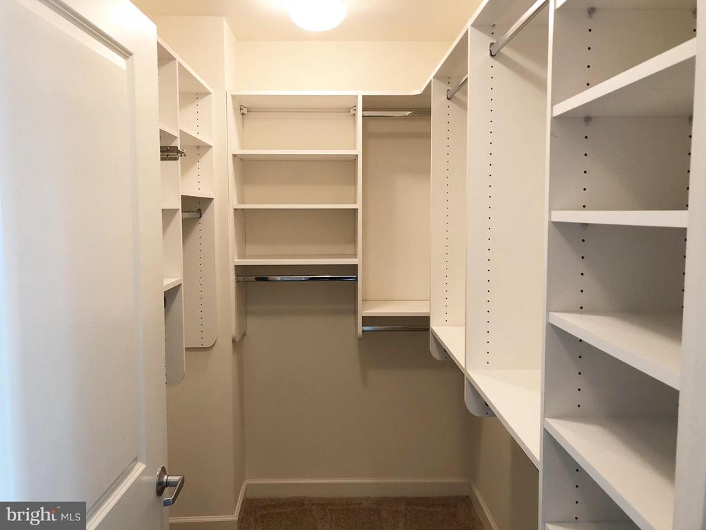 Primary bedroom walk-in closet has a custom system - 1830 FOUNTAIN DR #1008, RESTON