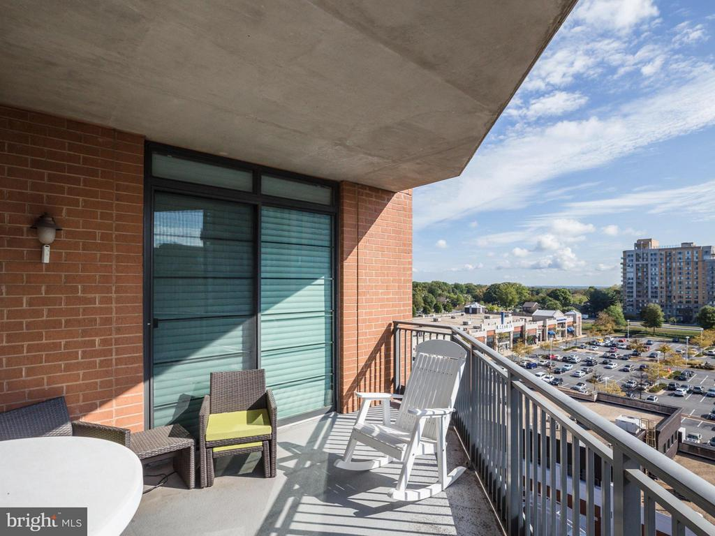 Relax out on the balcony with views of the east - 1830 FOUNTAIN DR #1008, RESTON