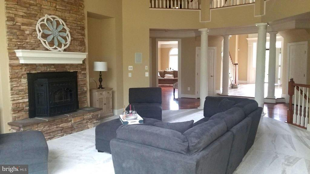 Floor to ceiling stone fpl has a cozy pellet stove - 18733 GROVE CHURCH CT, LEESBURG