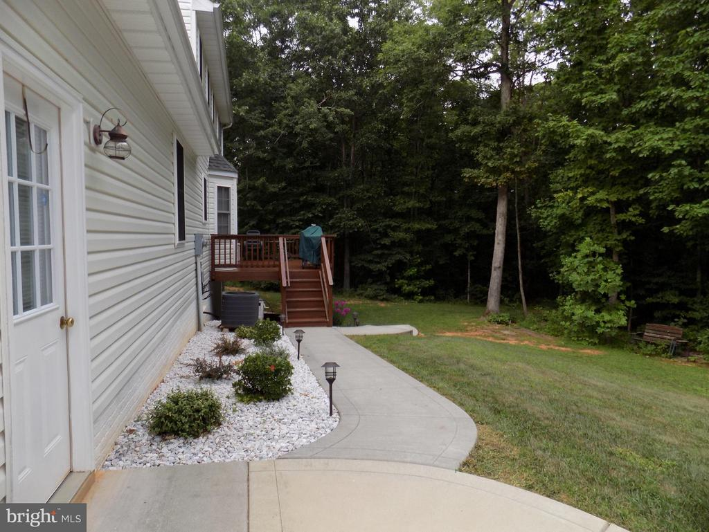 Exterior (Rear) Sidewalk to rear of home - 10285 REDBUD RD, UNIONVILLE