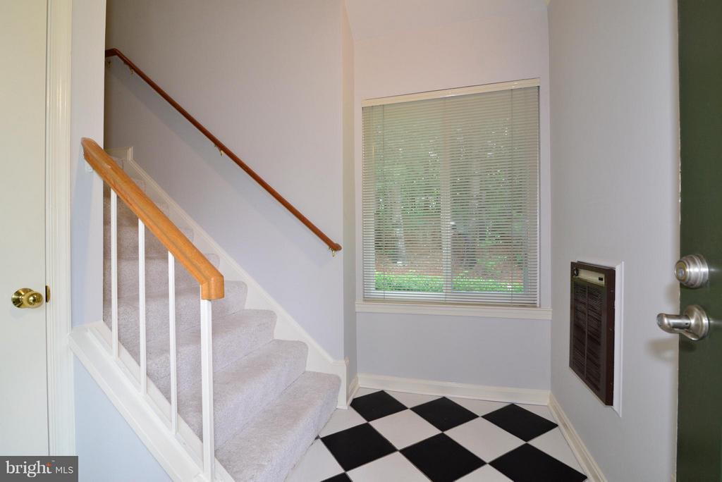 Ground Level foyer with closet and tile floor - 12258 FORT BUFFALO CIR #508, FAIRFAX