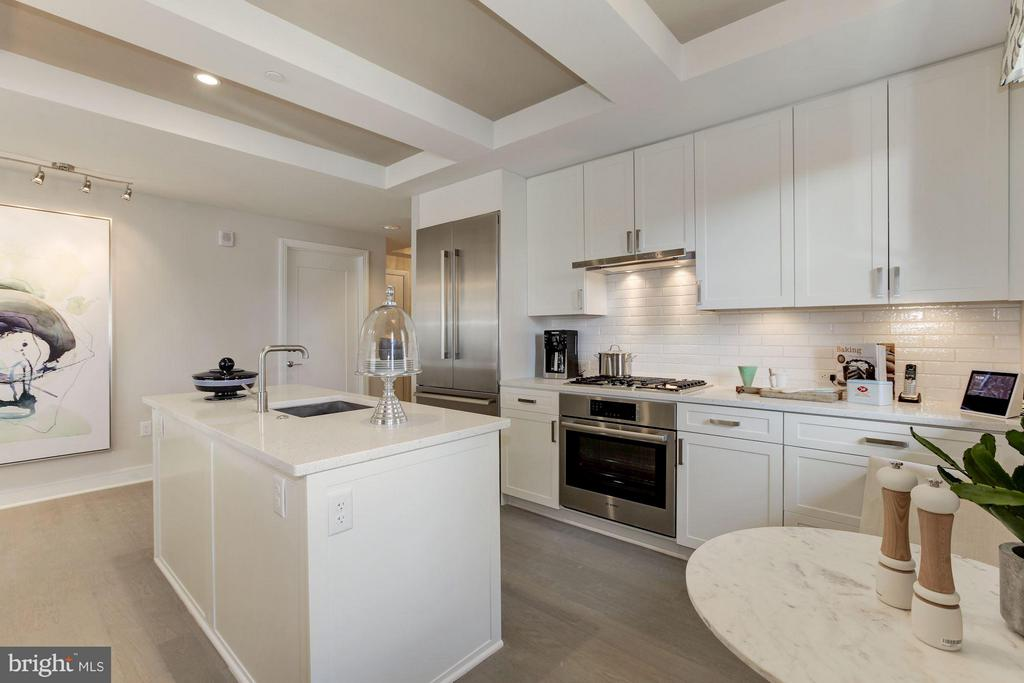 Kitchen with luxury appliances - 8302 WOODMONT AVE #801, BETHESDA