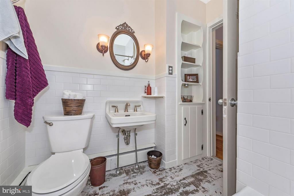Main level full bathroom. - 1722 SHOOKSTOWN RD, FREDERICK