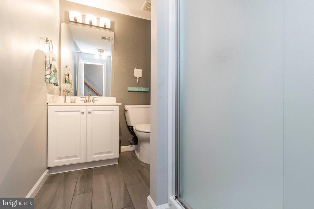 Lower level full bathroom with shower - 21043 ROAMING SHORES TER, ASHBURN
