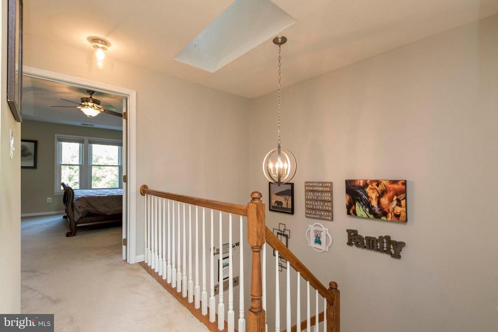 Lofty upstairs hallway - 21043 ROAMING SHORES TER, ASHBURN