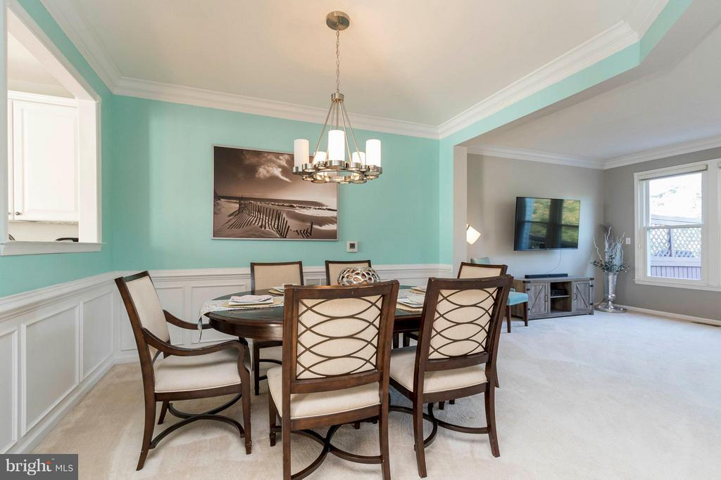Dining area accented with elegant wainscoting - 21043 ROAMING SHORES TER, ASHBURN