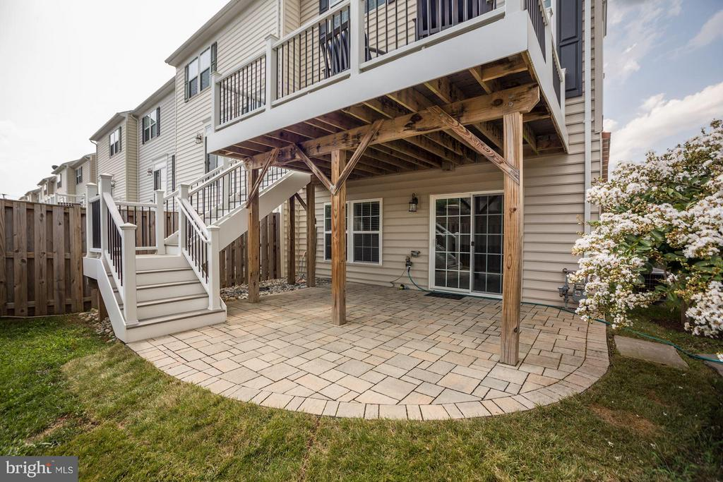 EXTERIOR REAR OF HOME - BEAUTIFUL STONE PATIO! - 6260 SUMMIT POINT CT, ALEXANDRIA