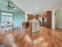 Kitchen features stainless steel appliances. - 3918 SWEET BRIAR LN, FREDERICK