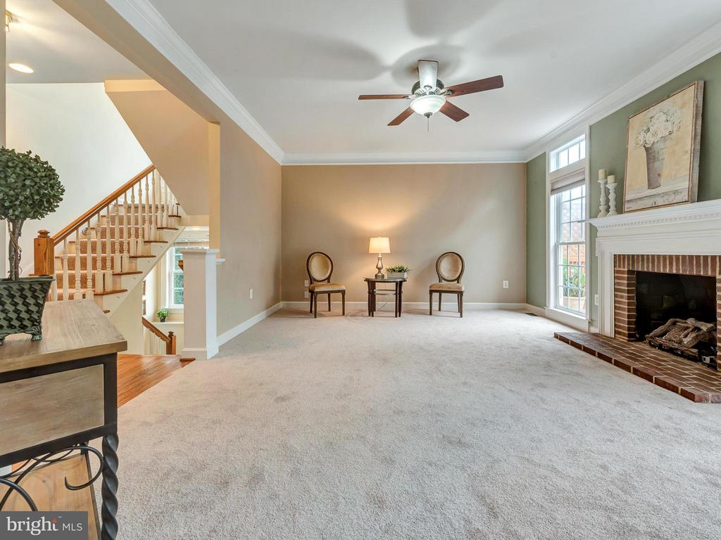 Family room with wood fireplace. - 3918 SWEET BRIAR LN, FREDERICK