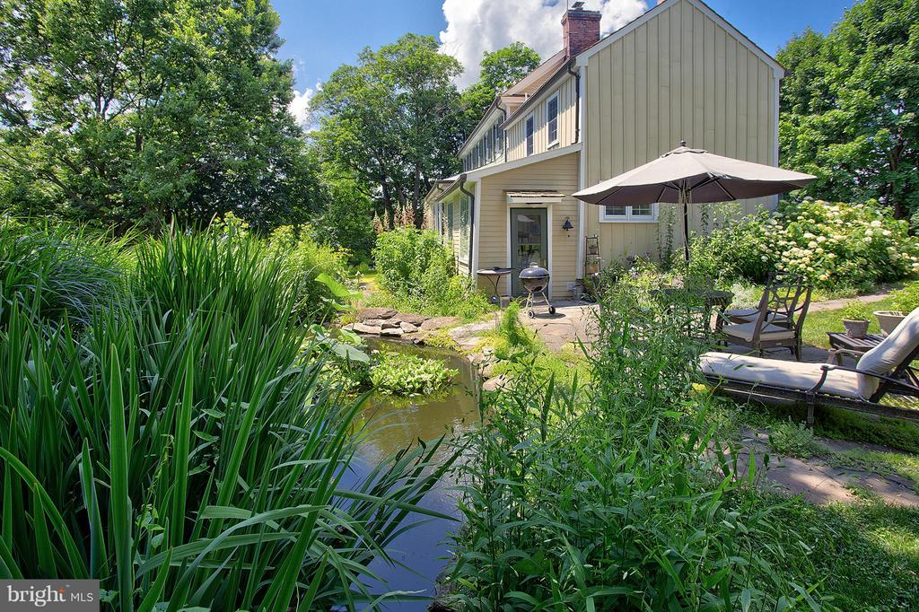 Pond, patio and main house - 15286 LOYALTY RD, WATERFORD