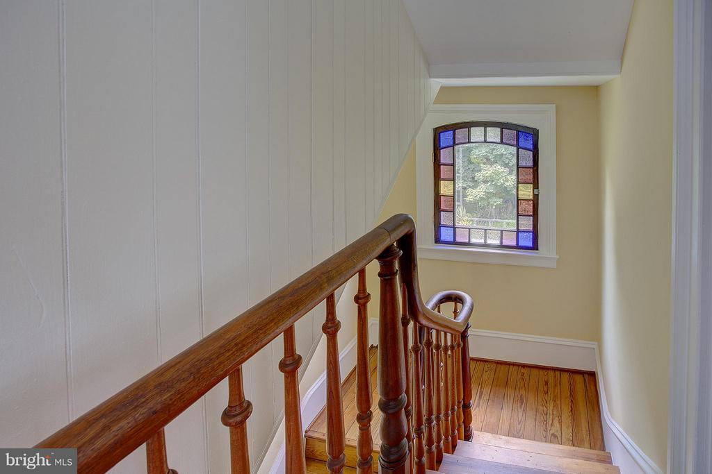 Gorgeous stained glass antique window in stairwell - 15286 LOYALTY RD, WATERFORD