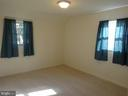 Spacious bedroom with new carpet - 12705 GOULD RD, SILVER SPRING