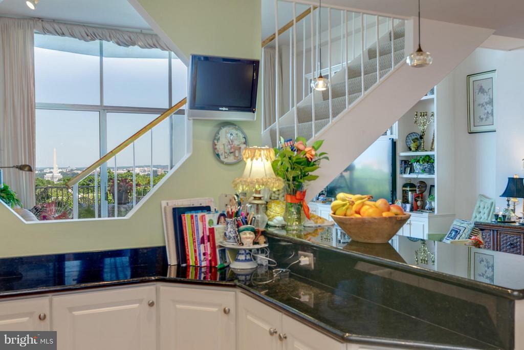 Kitchen w/window opening to LR - 1200 NASH ST N #551, ARLINGTON