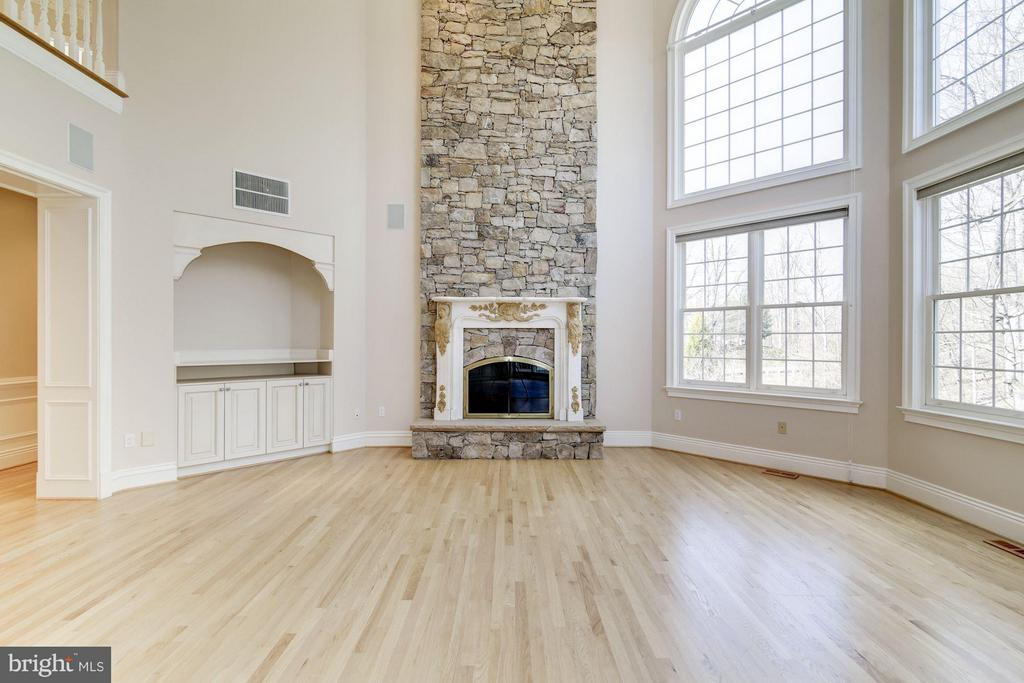 Stone fireplace, floor to ceiling windows - 11308 HEARTH CT, GREAT FALLS