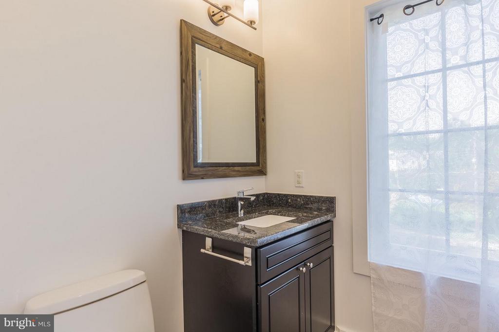 Each bedroom upstairs has a private full bathroom - 7337 PAXTON RD, FALLS CHURCH