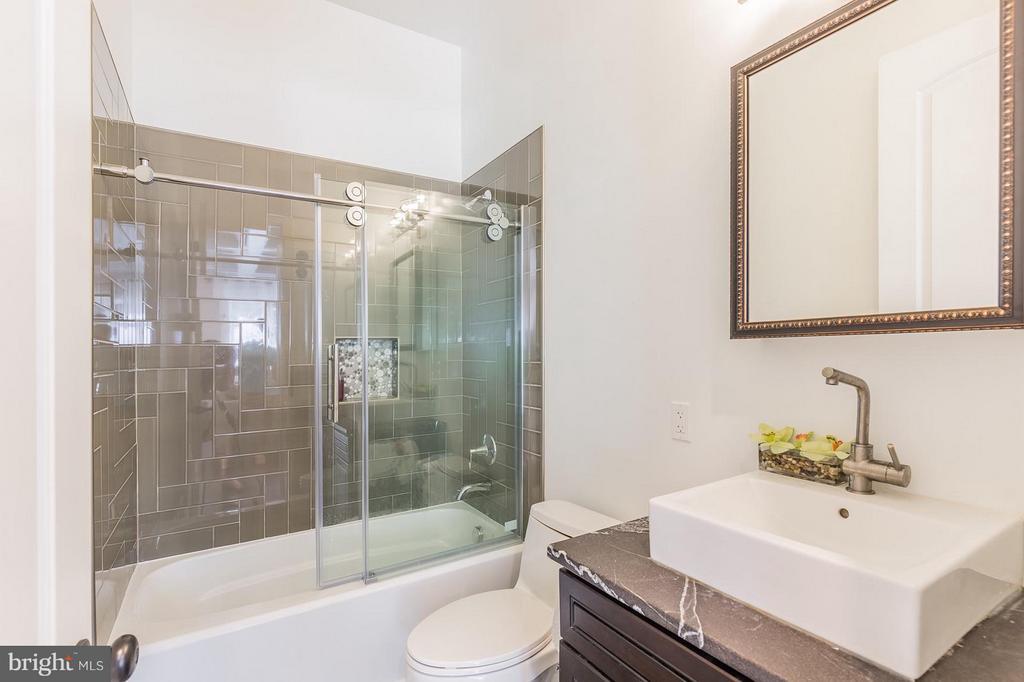 Main level full bath complete with premium tiles! - 7337 PAXTON RD, FALLS CHURCH