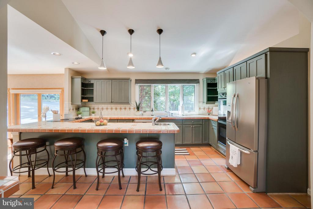 Have a seat at the bar in this EXPANSIVE Kitchen!! - 232 BEACHSIDE CV, LOCUST GROVE