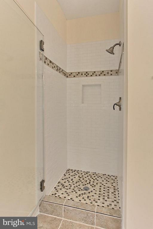 Stunning tile shower with rimless door - 1700 LAKE SHORE CREST DR #15, RESTON