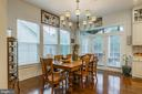 This is the breakfast room with rear porch access - 17041 SILVER ARROW DR, DUMFRIES