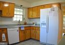Solid wood cabinets with Corian tops. - 3804 14TH ST N, ARLINGTON