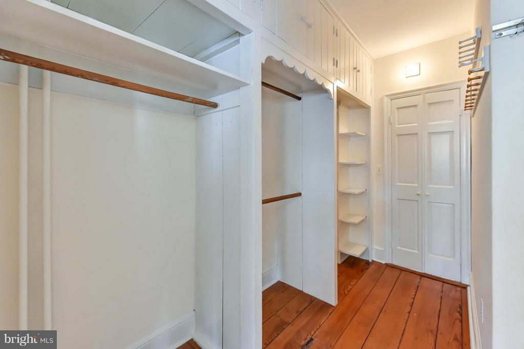 A walk-in master closet with extended storage - 307 WOLFE ST, ALEXANDRIA
