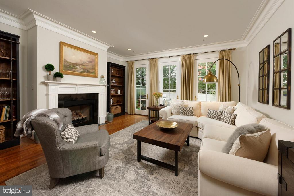 A grand living room with a wood burning fireplace - 711 UNION ST S, ALEXANDRIA