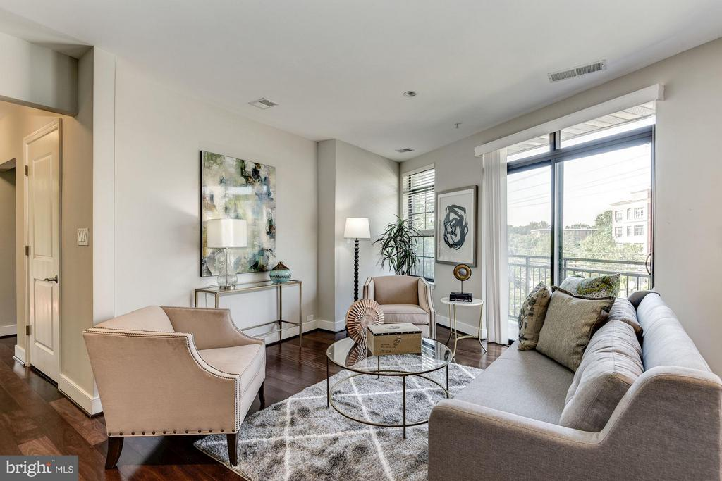 Living Room opens out to one of two balconies - 2702 LEE HWY #2B, ARLINGTON