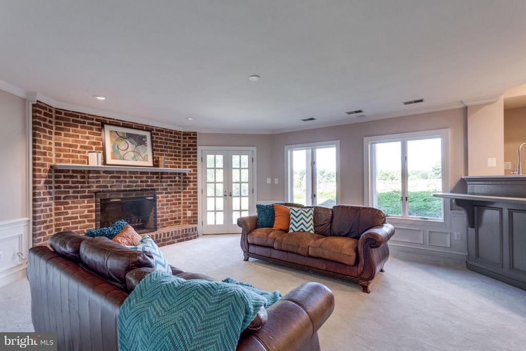 Walk-out Recreation Room with brick fireplace - 10431 NEW ASCOT DR, GREAT FALLS