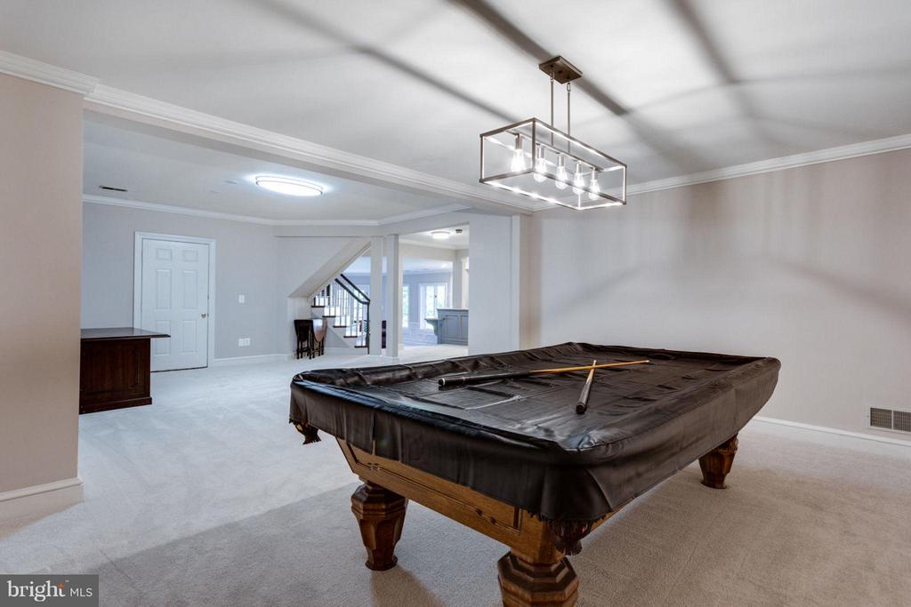 Expansive lower level Game Room - 10431 NEW ASCOT DR, GREAT FALLS
